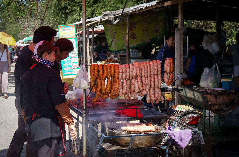 Men at market stall in city