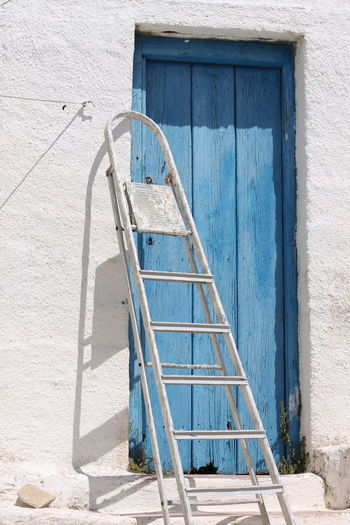 Ladder and closed door