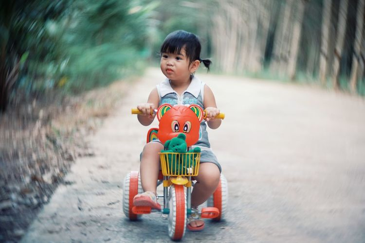 Cute Girl Riding Tricycle