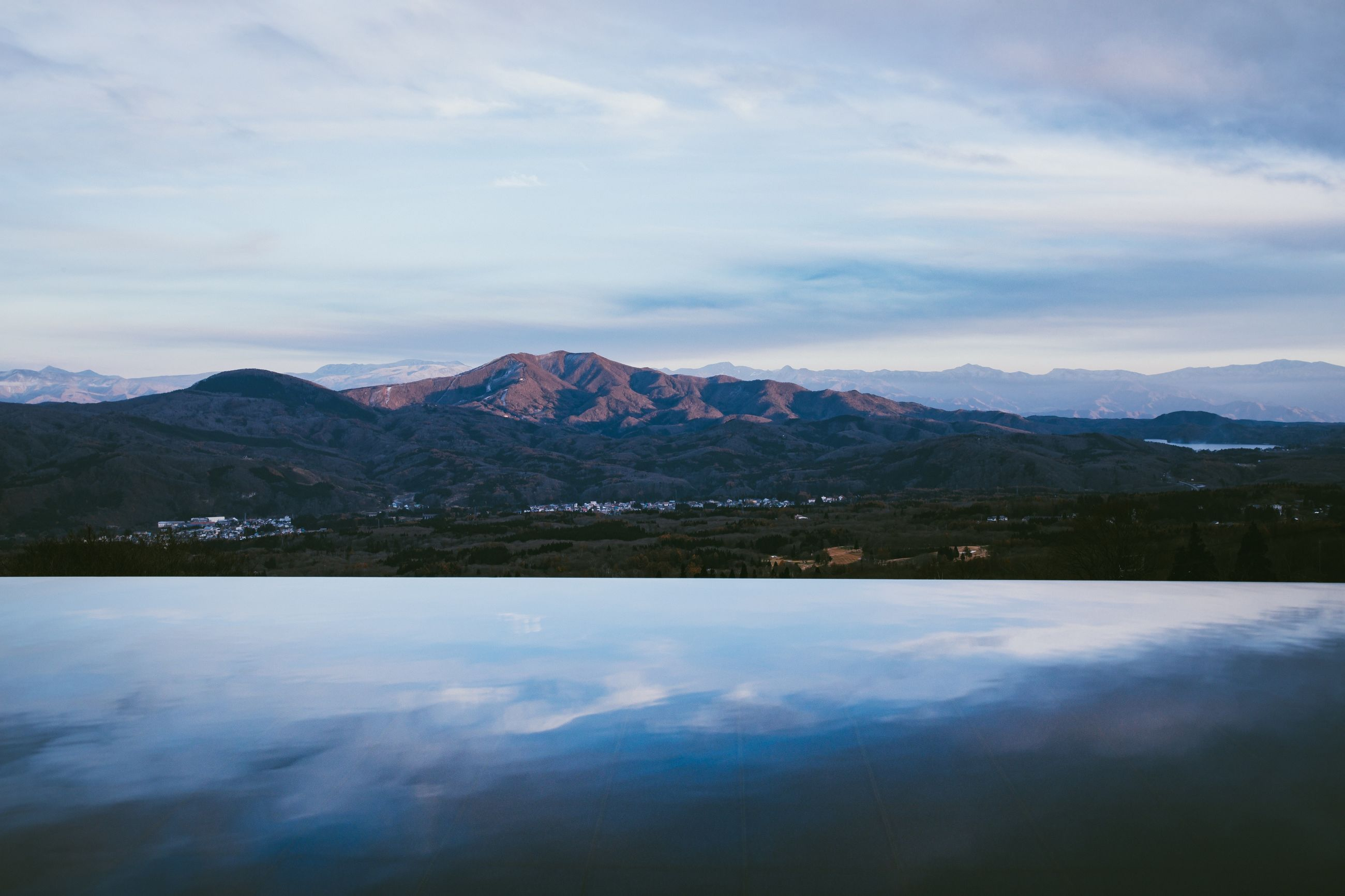 mountain, cloud - sky, beauty in nature, sky, scenics - nature, tranquil scene, tranquility, lake, non-urban scene, water, idyllic, mountain range, nature, reflection, no people, waterfront, environment, landscape, day, mountain peak