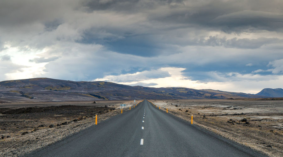 Cloud - Sky Sky Road Mountain Direction The Way Forward Transportation Landscape Environment Beauty In Nature Tranquil Scene Nature vanishing point Symbol Scenics - Nature Tranquility Diminishing Perspective No People Day Mountain Range Outdoors Dividing Line Long Iceland Road