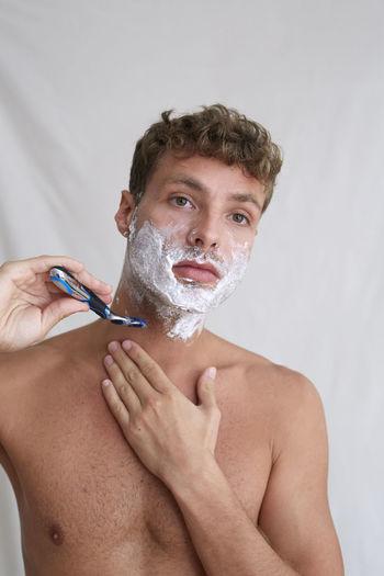 Portrait of young man in bathroom