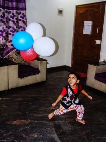 BOY PLAYING WITH BALLOONS One Boy Children Only One Person Child Balloon Full Length People Indoors