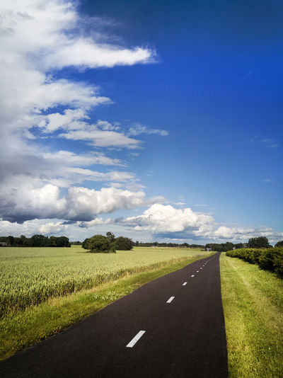 Walkway in Estonia Asphalt Beauty In Nature Cloud - Sky Clouds Countryside Day Dividing Line Field Field Grass Growth Landscape Nature No People Outdoors Pathway Road Rural Scene Scenics Sky The Way Forward Tranquil Scene Tranquility Transportation Walkway