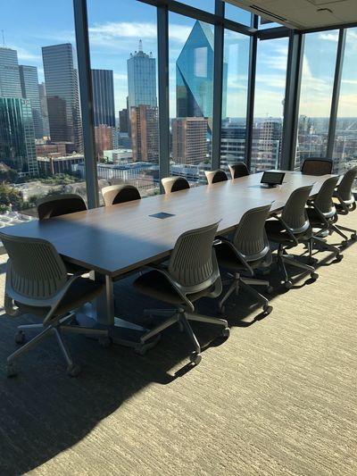 Boardroom with downtown city view. Boardroom with urban skyline in downtown Dallas. Cityscape Modern No People Business Architecture Board Room Office Corporate Business Indoors  Empty Meeting Office Chair Financial District  Urban Skyline Downtown District Dallas Texas Skyscraper Copy Space Looking Through Window In A Row Futuristic Window View Conference Interior Views