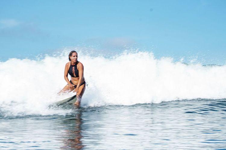 Full length of man splashing water in sea