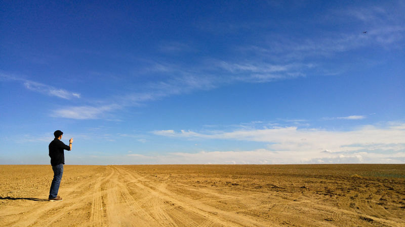 Plane Spotter Agriculture Big Sky Colorado EyeEmNewHere Farm Field Aircraft Airplane Barren Dust Empty Farming Landscape Man In Black One Man Only One Person Plains Pointing Prairie Sky Soil