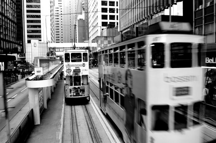 Building Exterior Architecture Built Structure City Transportation Mode Of Transport Public Transportation Day Outdoors People Adult Street Streetphotography City Black And White Black & White Movement In The Picture HongKong EyeEmNewHere Mobility In Mega Cities