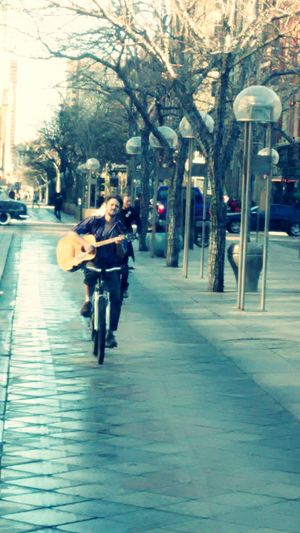 Urban Spring FeverMultitasking Downtown Taking Photos Check This Out Favorite Places Urban Lifestyle Singing Riding Bike Playing Guitar Urban Style Transportation Adventures In The City