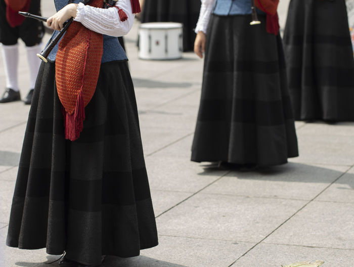 Woman is holding a bagpipe, spanish traditional dance group Asturias City Holiday Horizontal Music SPAIN Sunny Traditional Clothing Bagpipe City Day Folk Folklore Holding Lifestyles Outdoors Performance Pipe Band Real People Standing Summer Traditional Women
