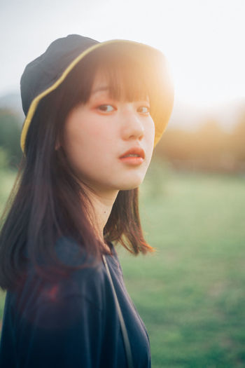 Portrait One Person Headshot Focus On Foreground Nature Lifestyles Sunlight Lens Flare Sky Young Adult Day Outdoors Looking Child