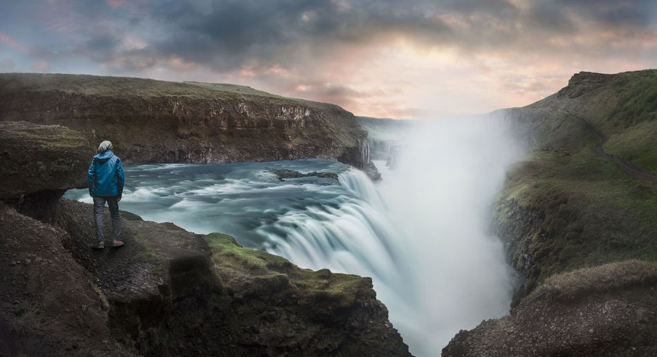 A picture taken at Gullfoss waterfall in Iceland Adult Beautiful Beauty In Nature Check This Out Cloud - Sky Day Fog Horizontal Landscape Light Motion Mountain Nature One Person Outdoors People Person Power In Nature Rock - Object Scenics Sky Travel Destinations Vacations Water Waterfall