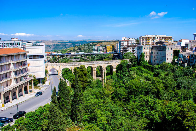 Ancient Blue Sky Bridge - Man Made Structure Bridges City Cityscape Clouds Day Green High Angle View Holidays Ibla Italy Landscape No People Outdoors Ragusa Sicily Sky Street Tourism Trees Urban Skyline