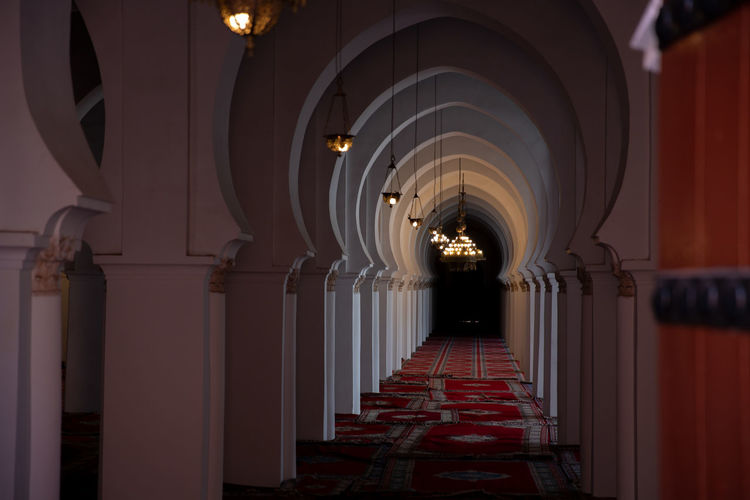 Architecture Arch The Way Forward Built Structure In A Row Direction Architectural Column Building Illuminated Lighting Equipment Diminishing Perspective Corridor Indoors  No People Place Of Worship Empty Repetition Ceiling Colonnade Aisle Electric Lamp