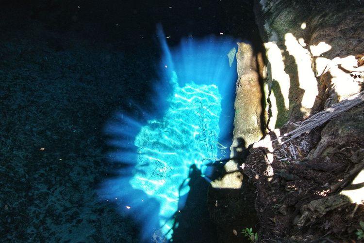 High angle view of illuminated blue sea