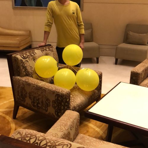 Headless Balloons Indoors  Food And Drink One Person Real People Table Food Sofa Lifestyles Yellow Wellbeing Business Standing