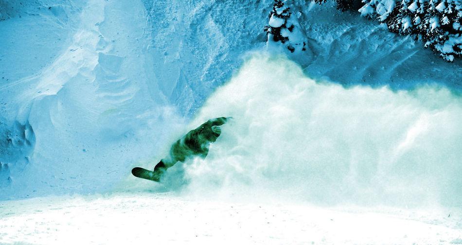 Snowboarder making a powder turn