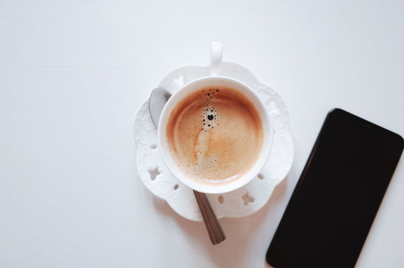 Coffee Cup Coffee - Drink Drink Mug Refreshment Coffee Cup Food And Drink Indoors  Still Life Table Freshness High Angle View Directly Above White Background Crockery Studio Shot Saucer No People Frothy Drink Non-alcoholic Beverage Breakfast