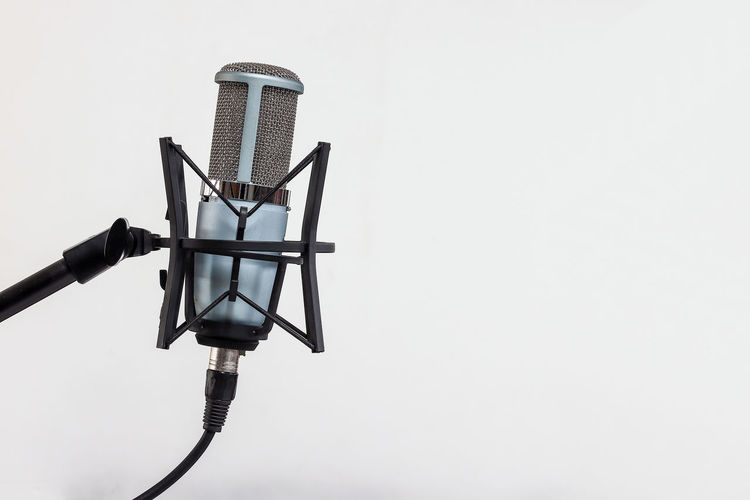 Microphone on white background Copy Space No People Metal Technology Sky Nature Low Angle View Connection Day Lighting Equipment Clear Sky White Background Outdoors Studio Shot Close-up Equipment Communication Electricity  Arts Culture And Entertainment