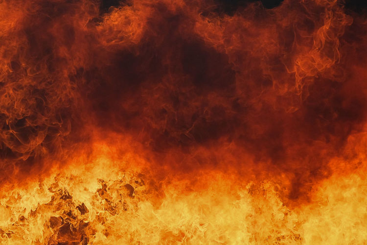 Abstract image of fire against orange sky