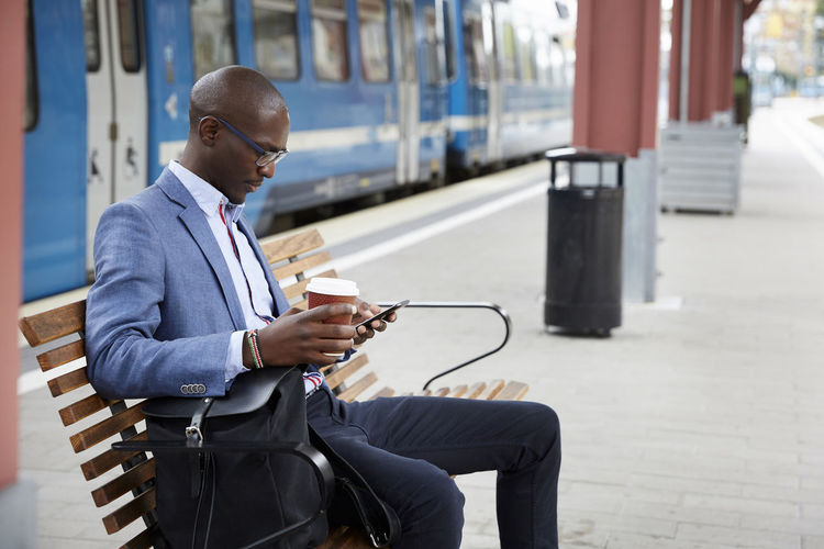 Man looking at camera while sitting on seat