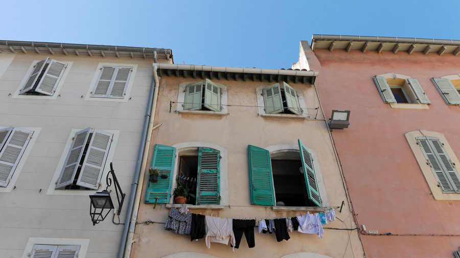 No People Summertime Summer Apartment Laundry Hanging Real People Balcony Clothing Outdoors Nature City Drying Day Clear Sky Residential District Low Angle View Building Built Structure Massilia Building Exterior Sky Blue Sky Architecture_collection Architecture Facade Building Façade Colorful Houses Colorful Windows Window Shutters Shutter Streetphotography Street Old Town Washing Marseille Clothes