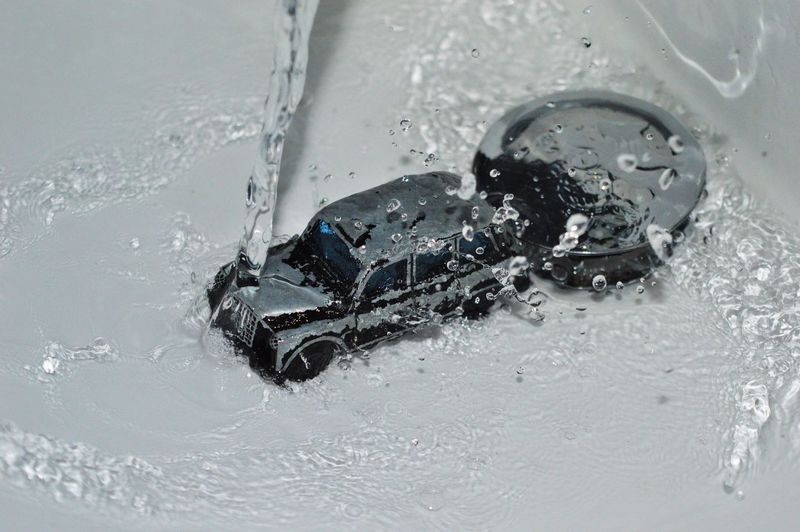 Black Black Cab Blackandwhite Cable Car Close-up Day Diecast Nature No People Outdoors Plug Sink Splash Taxi Toy Vintage Water Waterdrops Waterfall