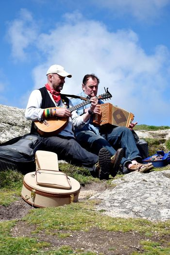 music everywhere Musical Instruments Accordion Connected With Nature Connected By Music Musicians Ways Of Seeing Stringed Instrument Cornish Musicians Local Musicians Men Togetherness Sitting Full Length Friendship Senior Adult Senior Men Sky Cloud - Sky Flat Cap Human Connection