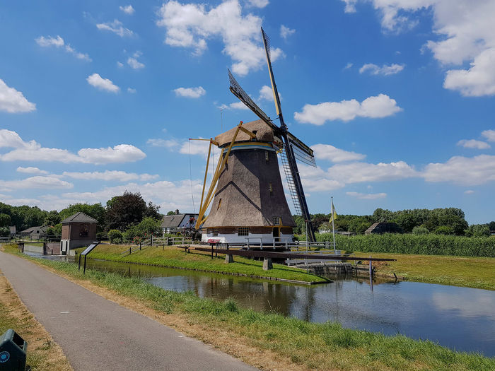 Windmill Windmills Alternative Energy Architecture Built Structure Cloud - Sky Day Environment Environmental Conservation Fuel And Power Generation Landscape Nature No People Outdoors Plant Renewable Energy Sky Traditional Windmill Tree Turbine Utrecht Water Wind Power Wind Turbine