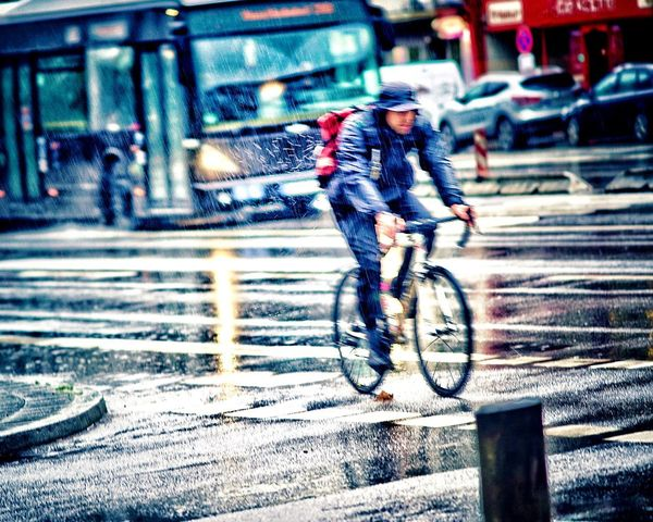 Biker in the Rain Wet Streets Bicycle Heavy Rain Transportation City Street Bicycle Real People Ride Land Vehicle Architecture Motion One Person Mode Of Transportation Sport City Life Men Wet Rain Road Lifestyles Riding Full Length