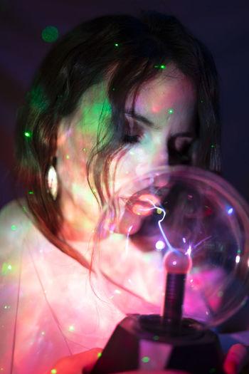 Portrait of woman holding bubbles