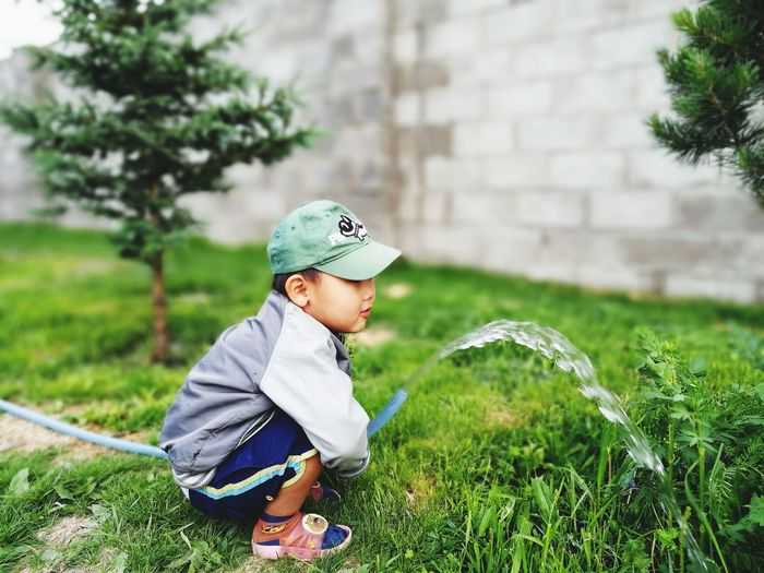Save the Trees With My Son ❤️ Childhood One Person Casual Clothing Grass One Boy Only Spraying Boys Child Males  People Water Full Length Day Nature Portrait Outdoors