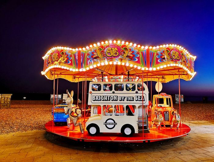 Bright1 England United Kingdom Uk Brighton Travel Photography Travel Sand Beach Mobile Photography Huawei P20 Pro P20 Pro Illuminated Arts Culture And Entertainment Amusement Park Ride Amusement Park Communication Night Carousel Multi Colored Glowing Outdoors No People