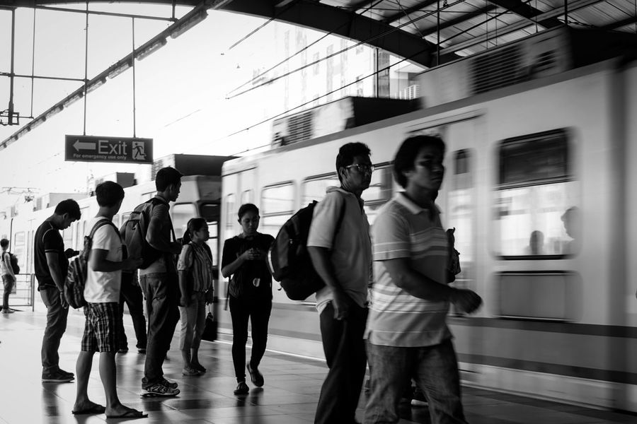 People Human Body Part Monochrome Photography People Photography Train Station PhilippinesEyeem Philippines Urban Scene Urban Lifestyle Monochrome Documentary Photo Street Photography Black And White Photography Real People Streetphotography Photojournalism Commuters Train Station Train Commuters