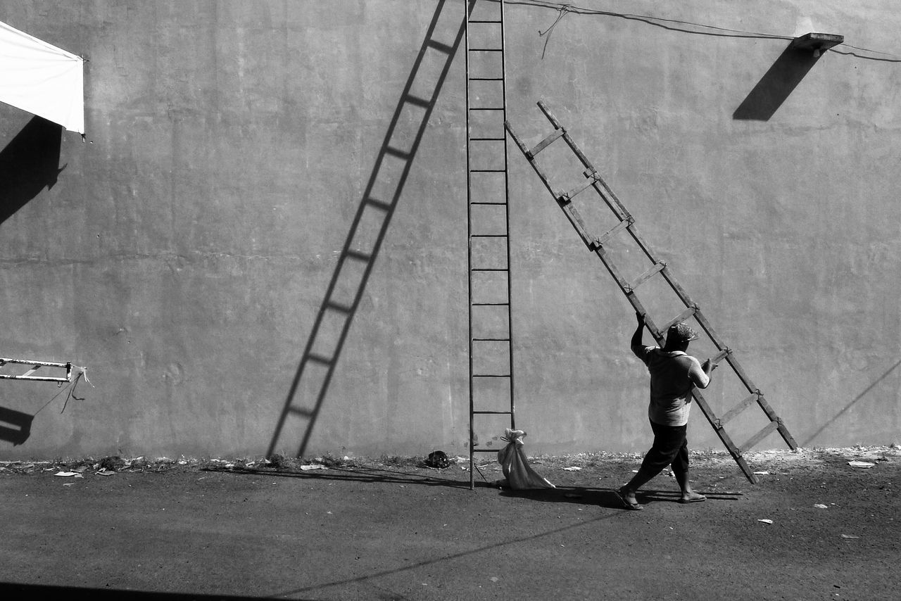 MAN WORKING WITH UMBRELLA