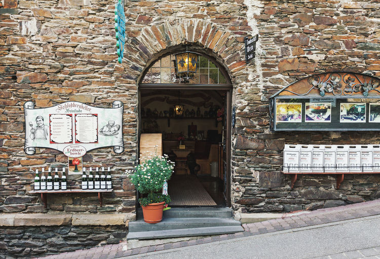 Wine restaurant and shop in Cochem, Germany German Culture Drink Leisure Activity Old Town Mosel Valley Wine Gastronomy Entrance Doors Wine Shop Winery Cochem Germany Bar Restaurant Day Door Building Exterior Store No People Outdoors