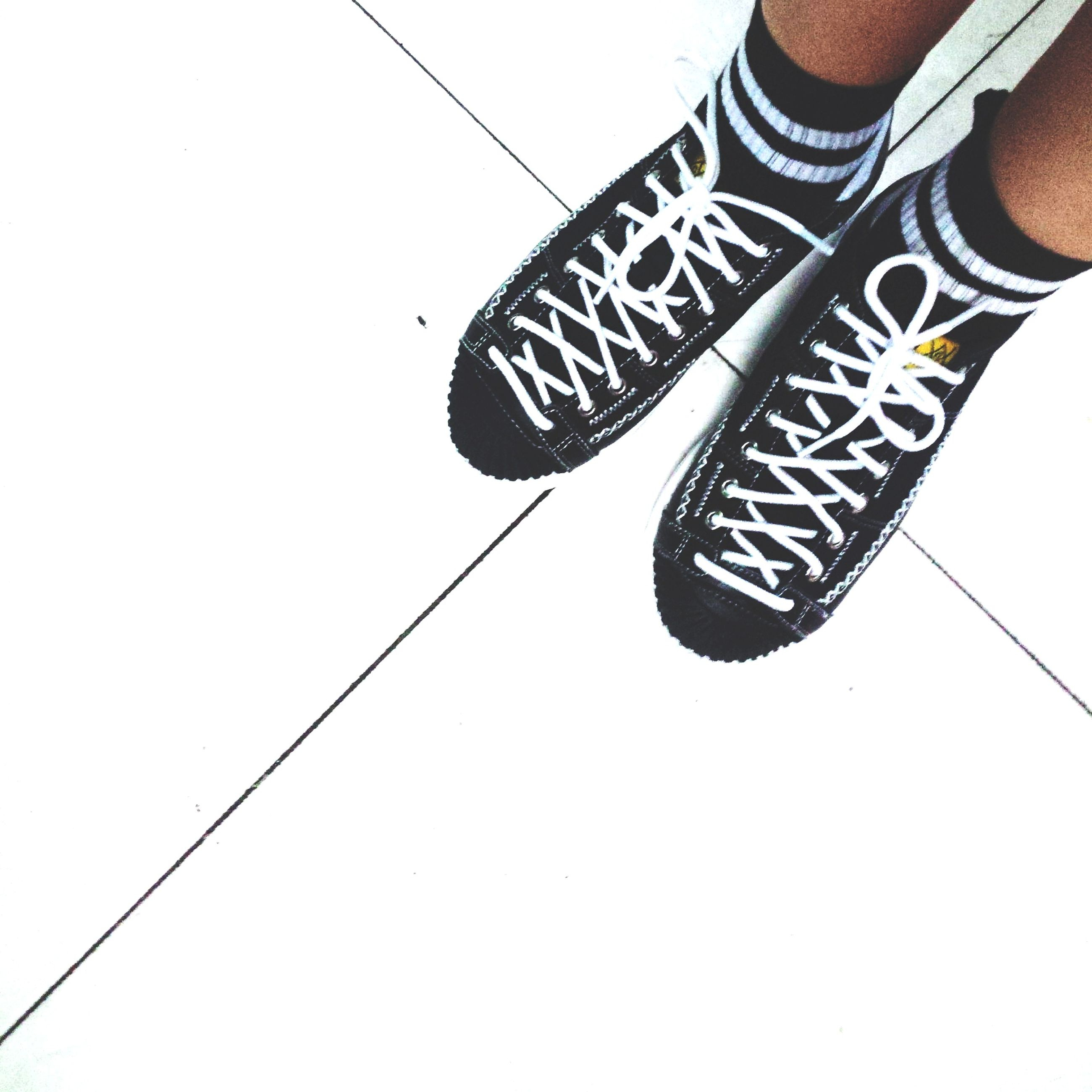 shoe, low section, person, part of, footwear, copy space, men, clear sky, unrecognizable person, cable, low angle view, leisure activity, lifestyles, day, close-up, outdoors, high angle view