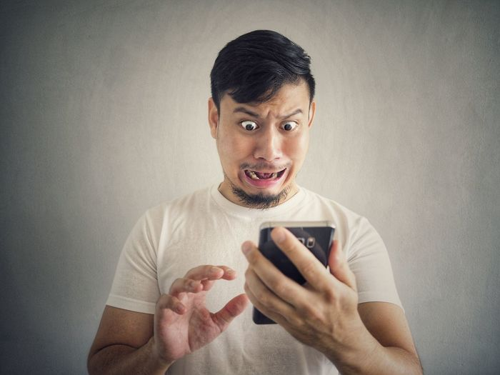 Shocked! Clip Share Face Scary Social Issues Social Smartphone Shock Funny Surprise Asian  Man EyeEm Selects Wireless Technology Portable Information Device Smart Phone Mobile Phone One Man Only Only Men Communication Technology One Person People Studio Shot Adult Internet Holding