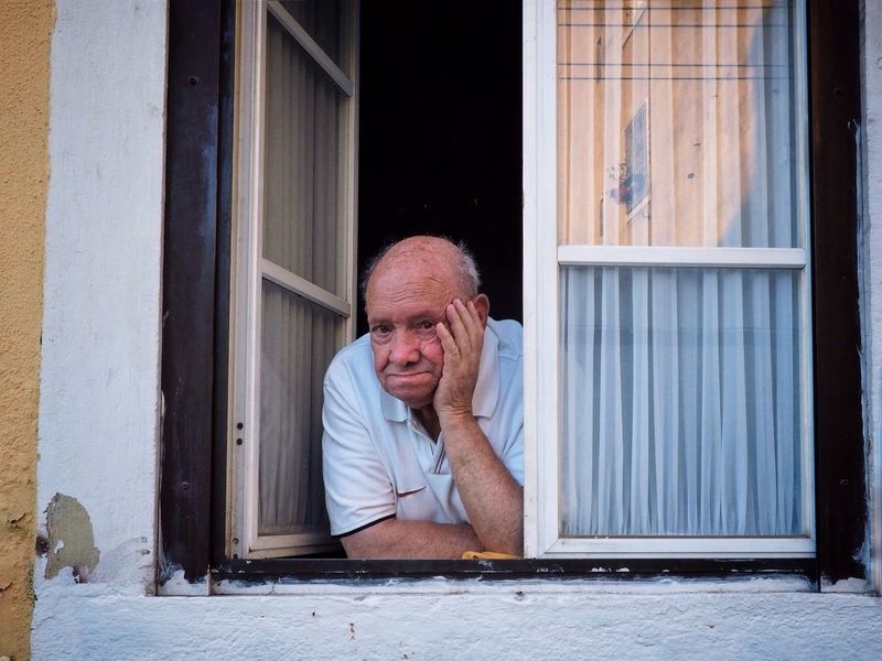 One Man Only Adults Only Window One Person Mature Adult Building Exterior Lisbon Portrait Portugal Depression - Sadness Senior Adult Front View One Mature Man Only Adult Mature Men Sitting Gray Hair Outdoors House People Retirement One Senior Man Only This Is Masculinity