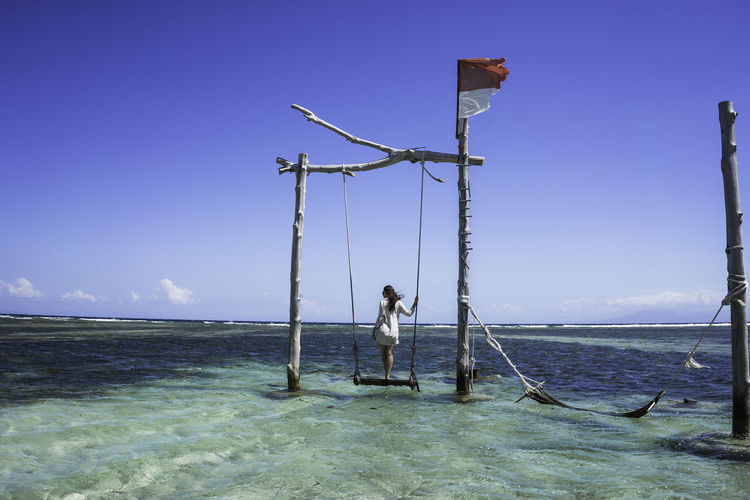 INDONESIA Beauty In Nature Blue Clear Sky Day Gili Trawangan Human Arm Land Leisure Activity Lifestyles Nature Non-urban Scene One Person Outdoors Real People Scenics - Nature Sea Sky Standing Water Waterfront