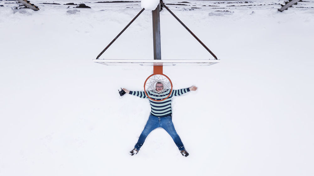 Winter basketball Drone  Drone Bascket Drone Selfy Casual Clothing Clothing Cold Temperature Day Drone Selfie Front View Full Length Leisure Activity Lifestyles Men Nature One Person Real People Snow Sport Standing Striped Warm Clothing Winter Winter Basketball Young Adult The Creative - 2018 EyeEm Awards