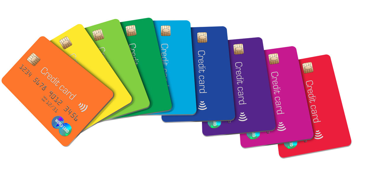 Here is a grouping of credit card in a spectrum of color. In A Row Isolated Spectrum Bank Notes Colorful Credit Cards Credit Card Debit Card Security Group Of People Rainbow Of Colors