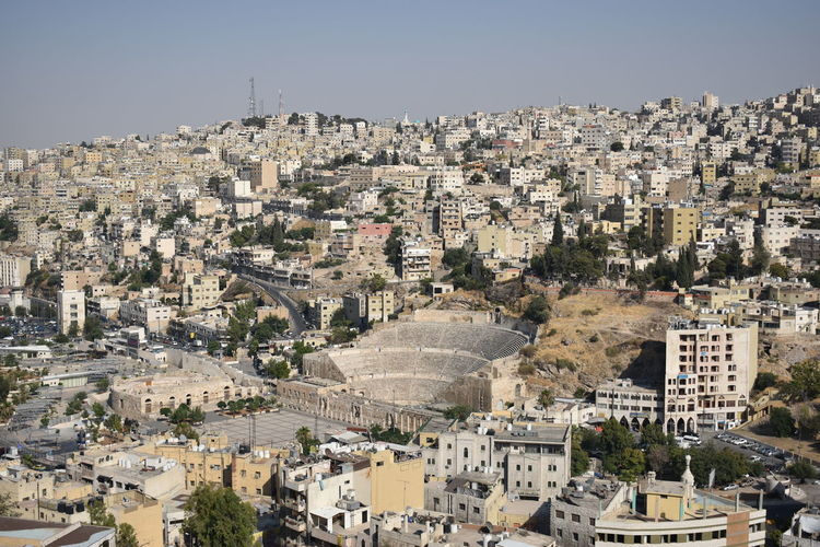 High angle view of townscape against clear sky in amman, jordan