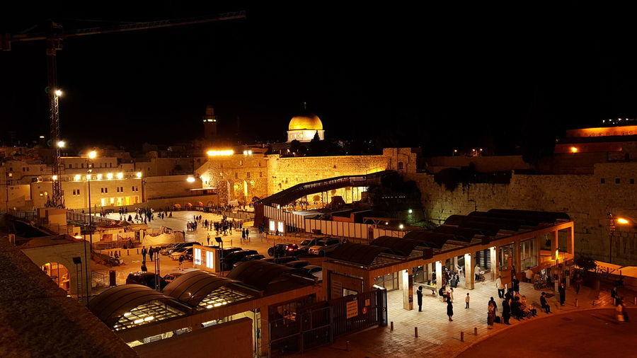 Western wall Western Wall History Jerusalem Jewish Gigi City Illuminated Nightlife Christmas Lights Christmas Market Sky Architecture Building Exterior Office Building Urban Scene Christmas Cityscape Christmas Ornament Tree Topper Christmas Present Christmas Decoration Bauble Christmas Bauble Residential District Religious Celebration Origins Religious Event Human Settlement Crowded Skyline HUAWEI Photo Award: After Dark