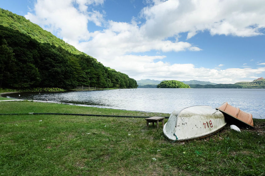 Hokkaido Shikotsu Toya National Park Beach Beauty In Nature Caldera Lake Cloud - Sky Day Grass Green Color Lake Lake Toya Land Nakajima Nature Nautical Vessel No People Outdoors Plant Scenics - Nature Sky Summer Tranquil Scene Tranquility Tree Water