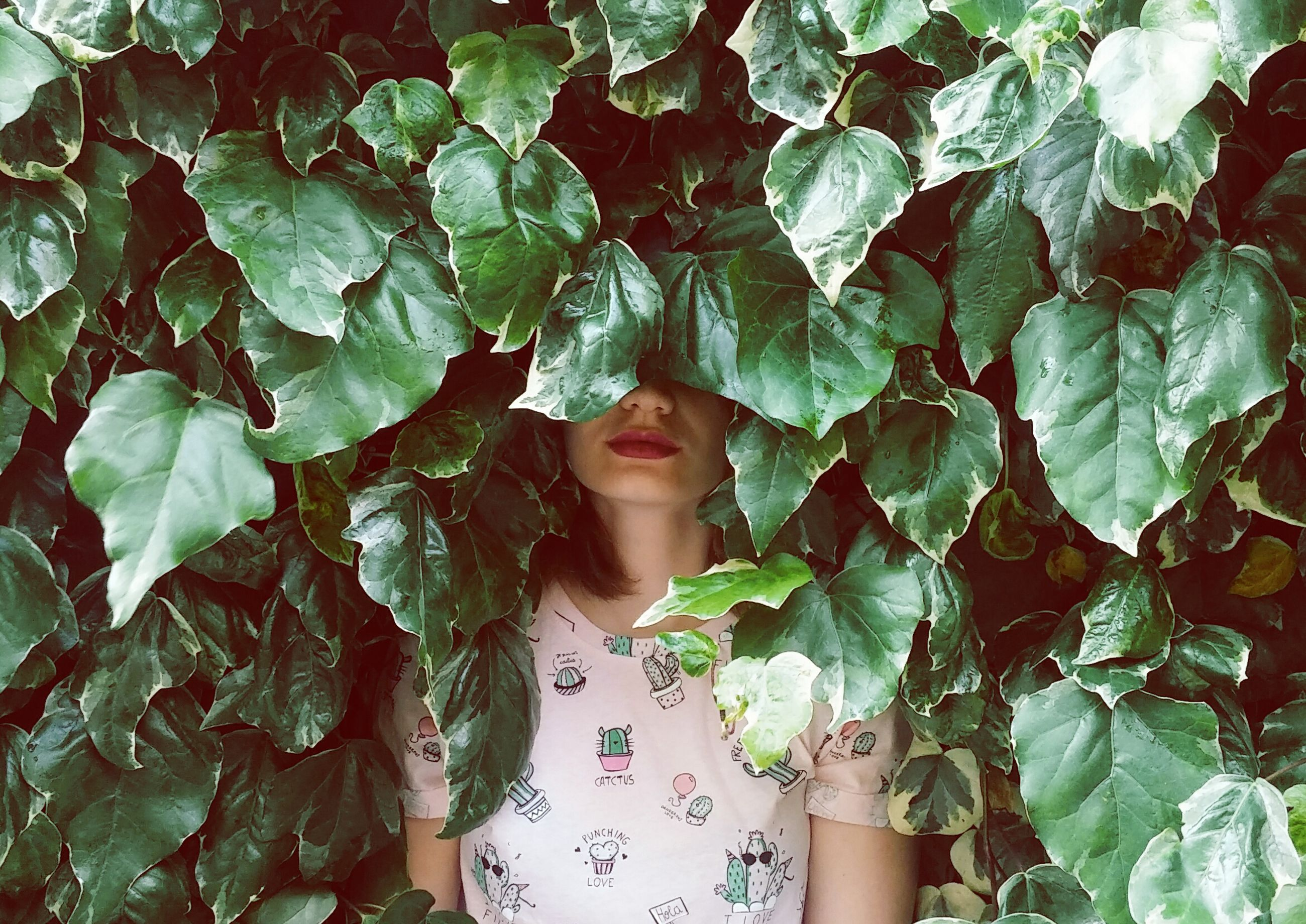 one person, leaf, plant part, young adult, real people, young women, women, green color, front view, adult, lifestyles, portrait, leisure activity, standing, nature, plant, day, beauty, beautiful woman, leaves, hairstyle, digital composite