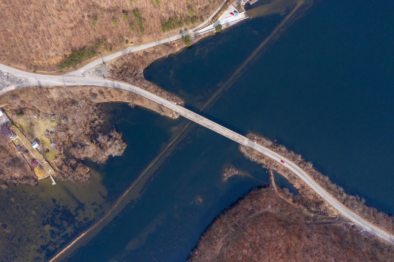 Aerial view of a bridge crossing a lake from a drone Aerial View Environment No People Road Nature Water Transportation Day Outdoors Scenics - Nature High Angle View Lake Lake View Sea Bridge Bridge - Man Made Structure Aerial Aerial Photography Aerial Shot Aerial Landscape Drone  Dronephotography Droneshot Bridge Over Lake Epic Aerial