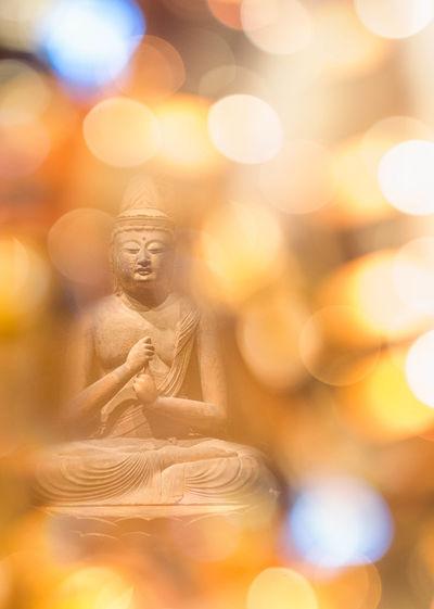Close-Up Of Illuminated Buddha Statue