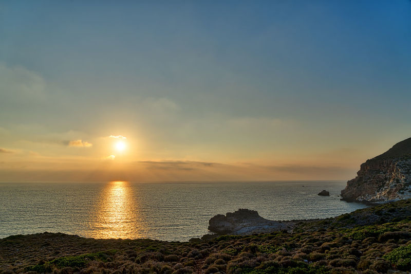 Landscape Evening Sunset Sky Cloudscape Horizon Water Scenics - Nature Beauty In Nature Nature No People Outdoors Sea Rock Land Beach Solid Rock - Object Tranquility Tranquil Scene Horizon Over Water Idyllic Sun Rock Formation Rocky Coastline