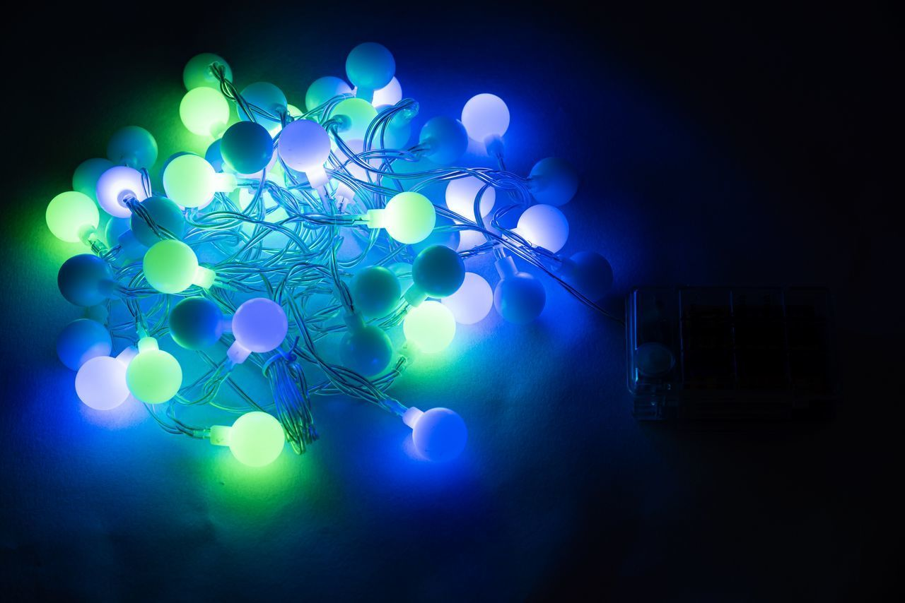 illuminated, lighting equipment, blue, glowing, celebration, decoration, night, indoors, no people, event, light - natural phenomenon, dark, arts culture and entertainment, connection, nightlife, multi colored, technology, light, nightclub, lens flare, abstract, electricity, purple, ceiling